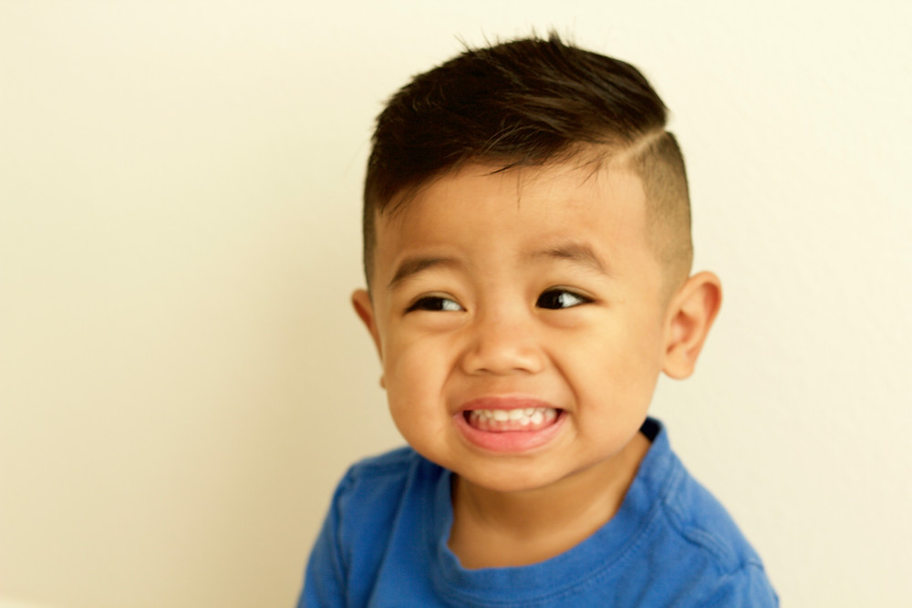 Boys Hair Cut: Under Cut with a Hard Part, skin on the sides, with a drop fade in the back