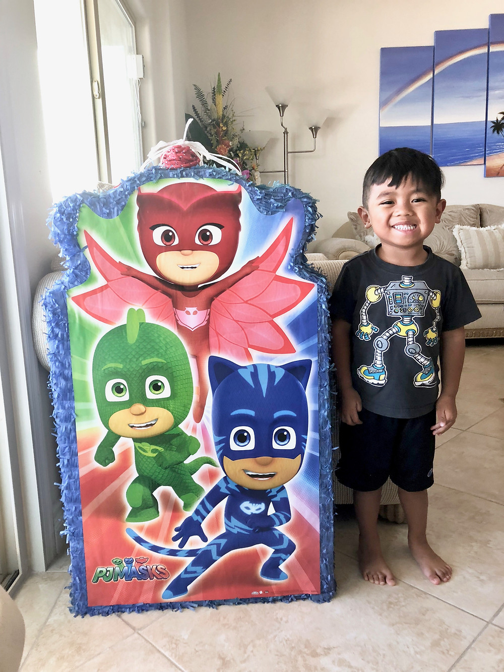 PJ Mask Piñata for a 3 year old birthday party // sunnyinjune.com august recap
