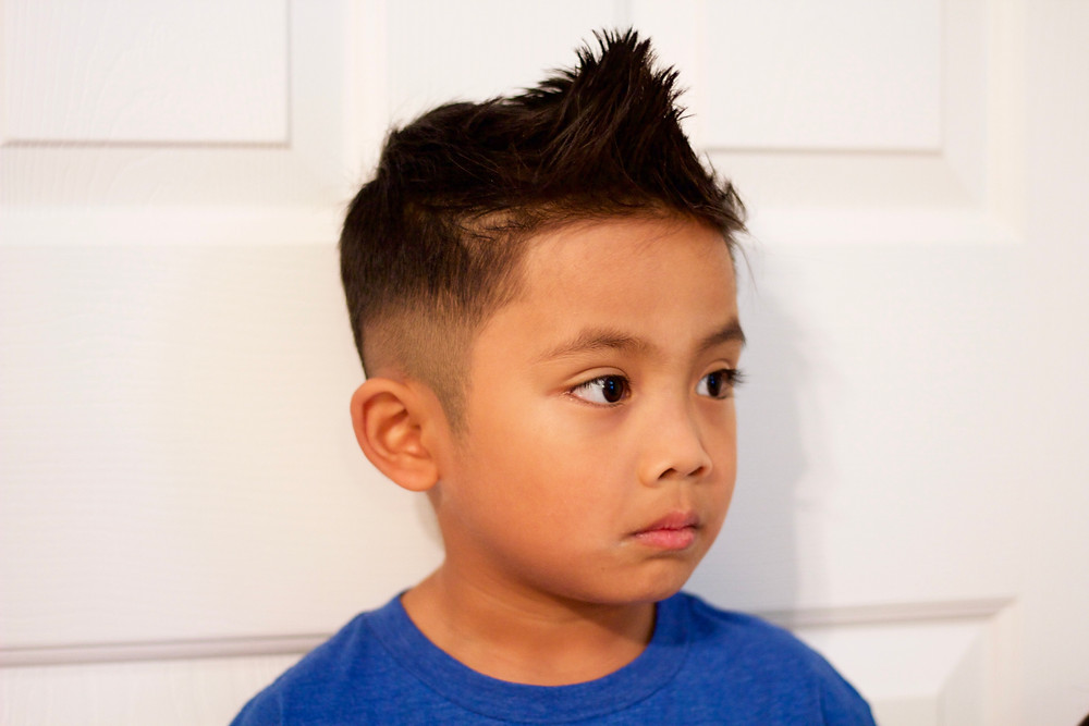 Boys Haircut: Faux Hawk with Medium Skin on the sides and a Drop Fade in the Back