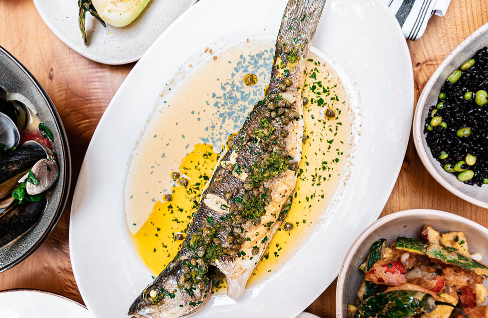 our whole fish and sides, a signature dish at The Shuckery