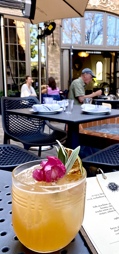 fancy looking cocktail on our outdoor table.