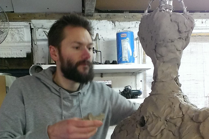 ON GOES THE CLAY