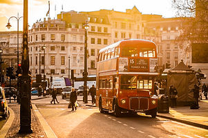 Canva - Red Double Decker Bus on Street