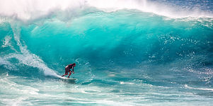 Canva - Person Surfing.jpg