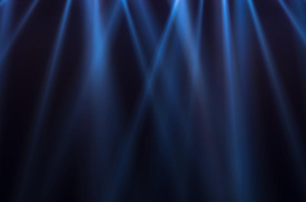 Blue luminous rays on a dark background.
