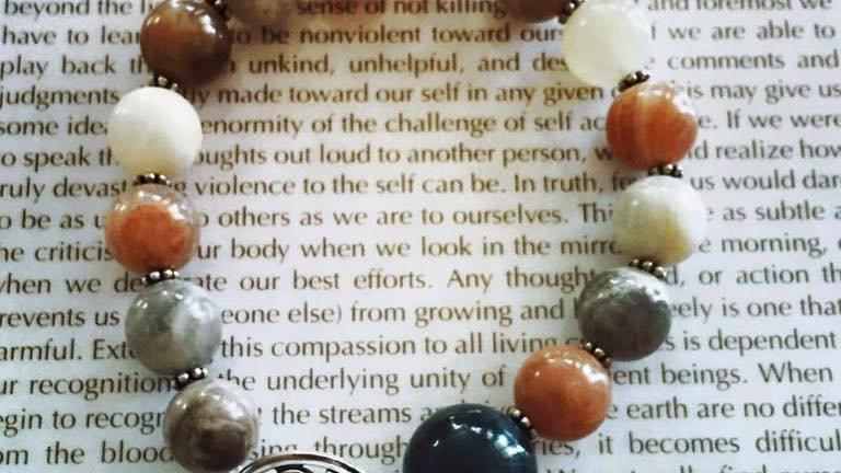 Peach Moonstone & Silver Beads with Silver Om & Cream Tassel Bracelet