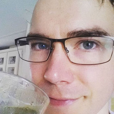 Luke G Rogers drinking green juice