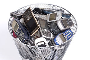 rubbish bin full of old cellphones.jpg