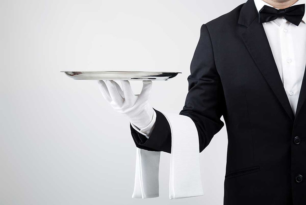 butler-with-white-gloves-holding-a-silve