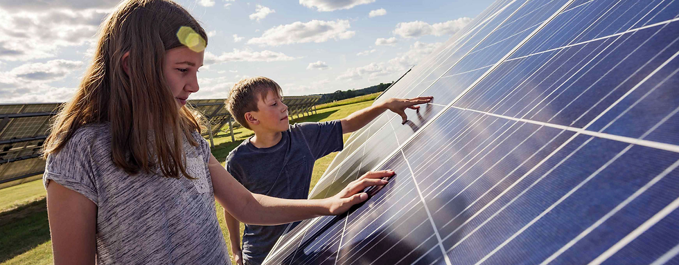 girl and boy with solar panels