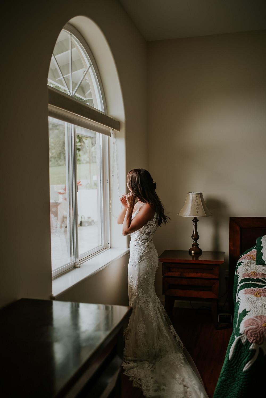 bride in window wedding photo