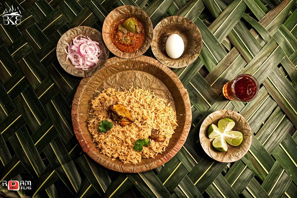 Chicken biriyani with accompaniments and black tea. Shot by Ramakrishna D