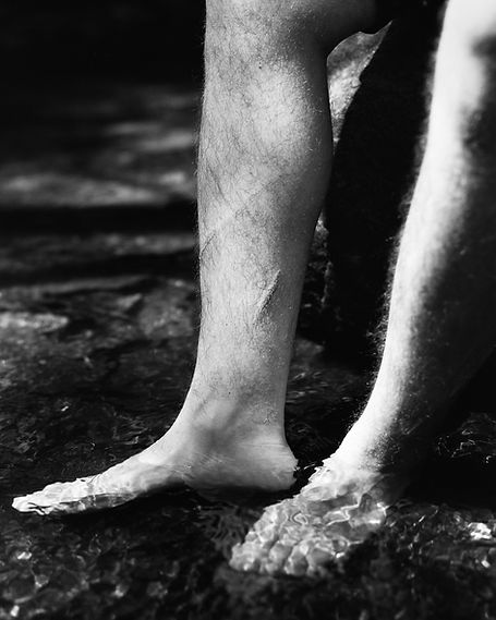 feet standing in water, wounds