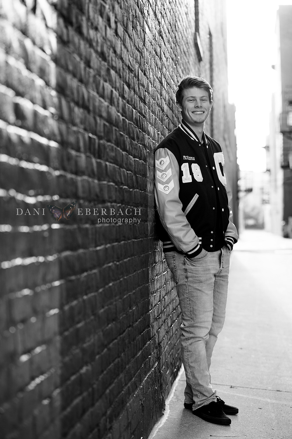 Black and white senior portrait in Fort Wayne alley
