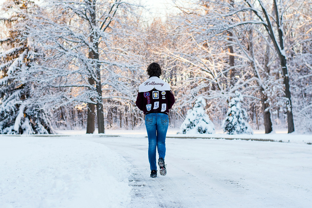 High school senior walking in snow