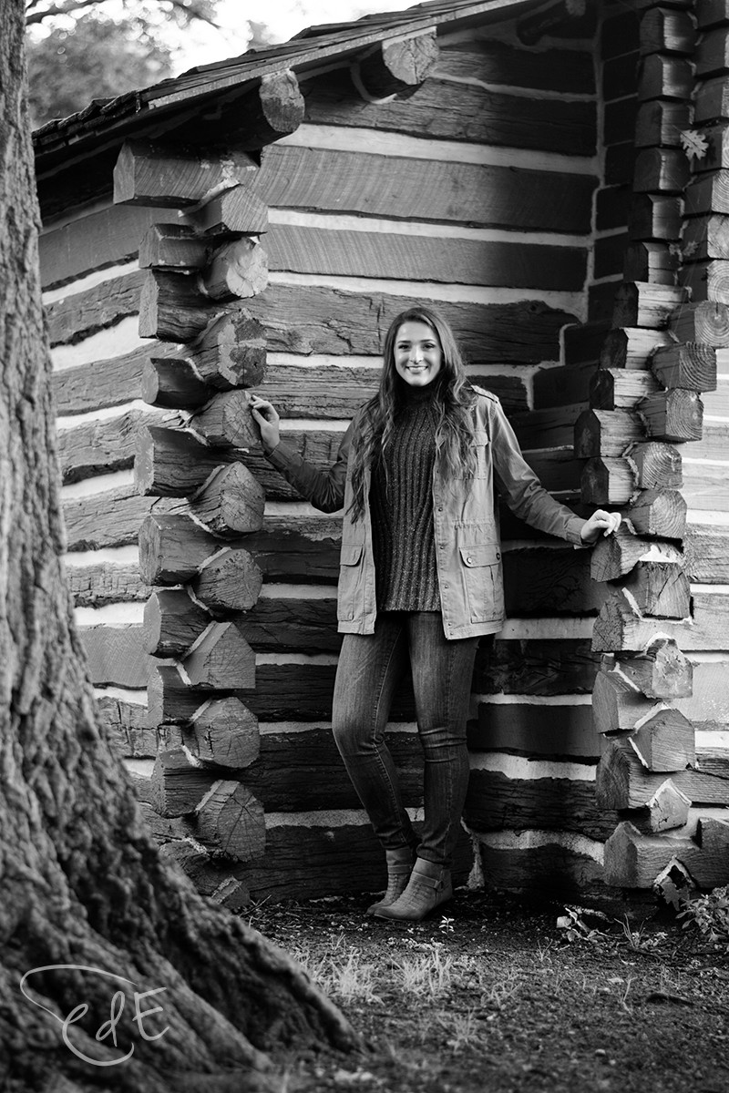 Black and white senior pictures with Foster Park cabin