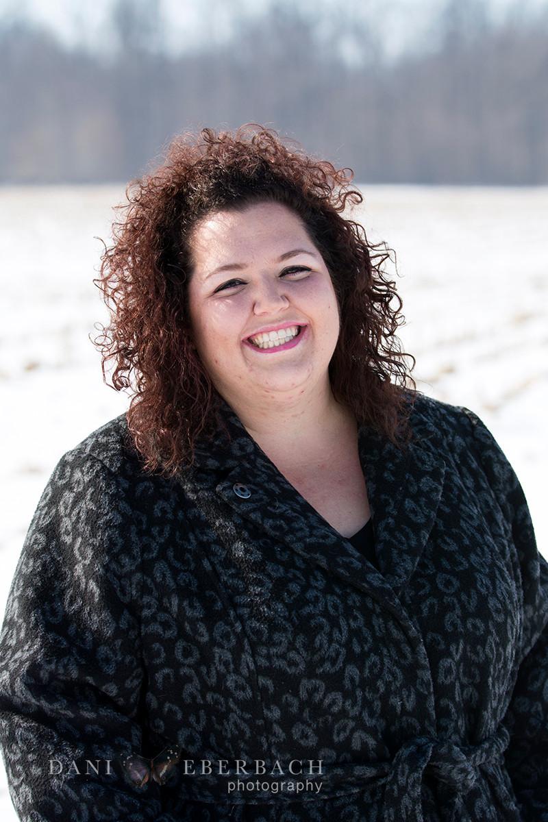 Portrait in snowy field in Indiana