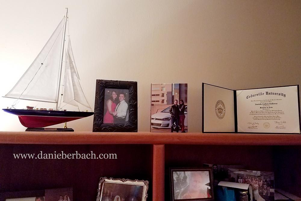 Image folio and other mementos on display shelf