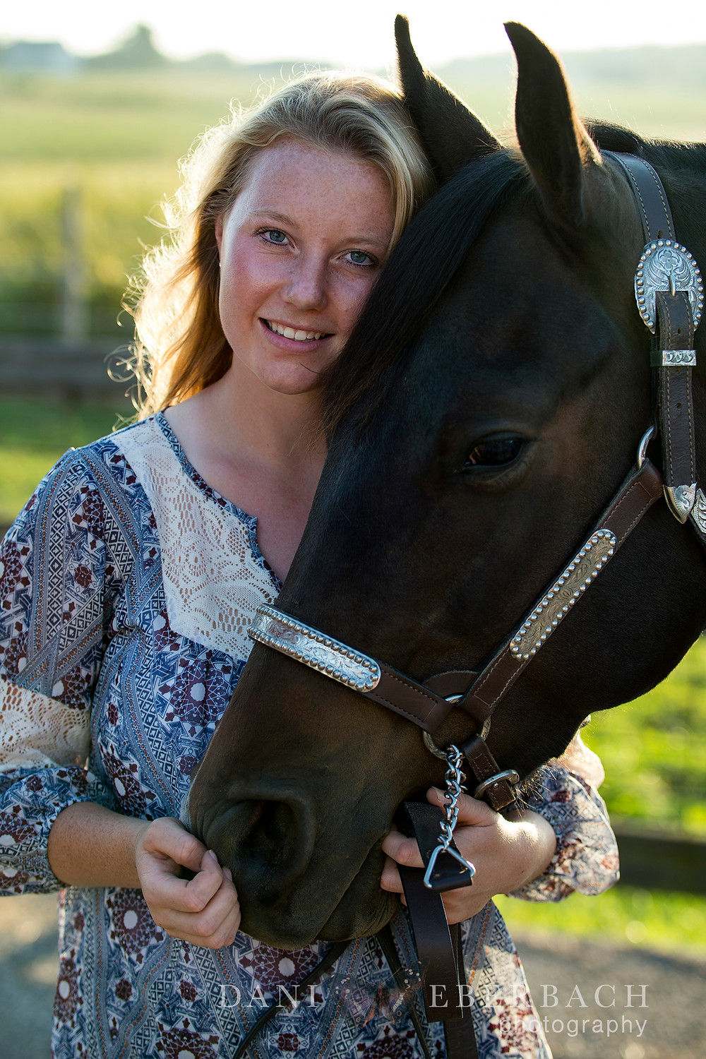 Senior portrait of young woman with horse