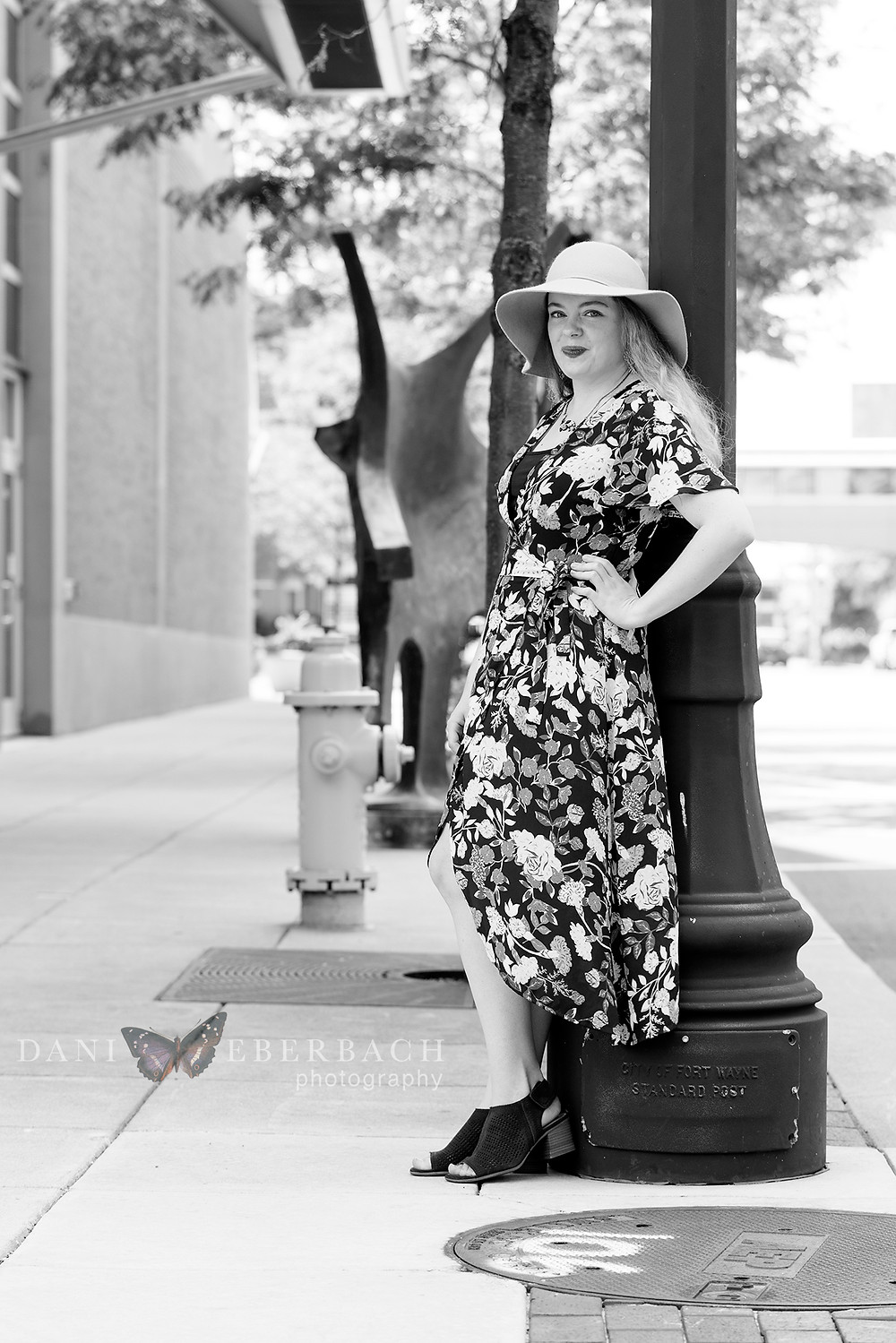 Black and white portrait on downtown Fort Wayne sidewalk
