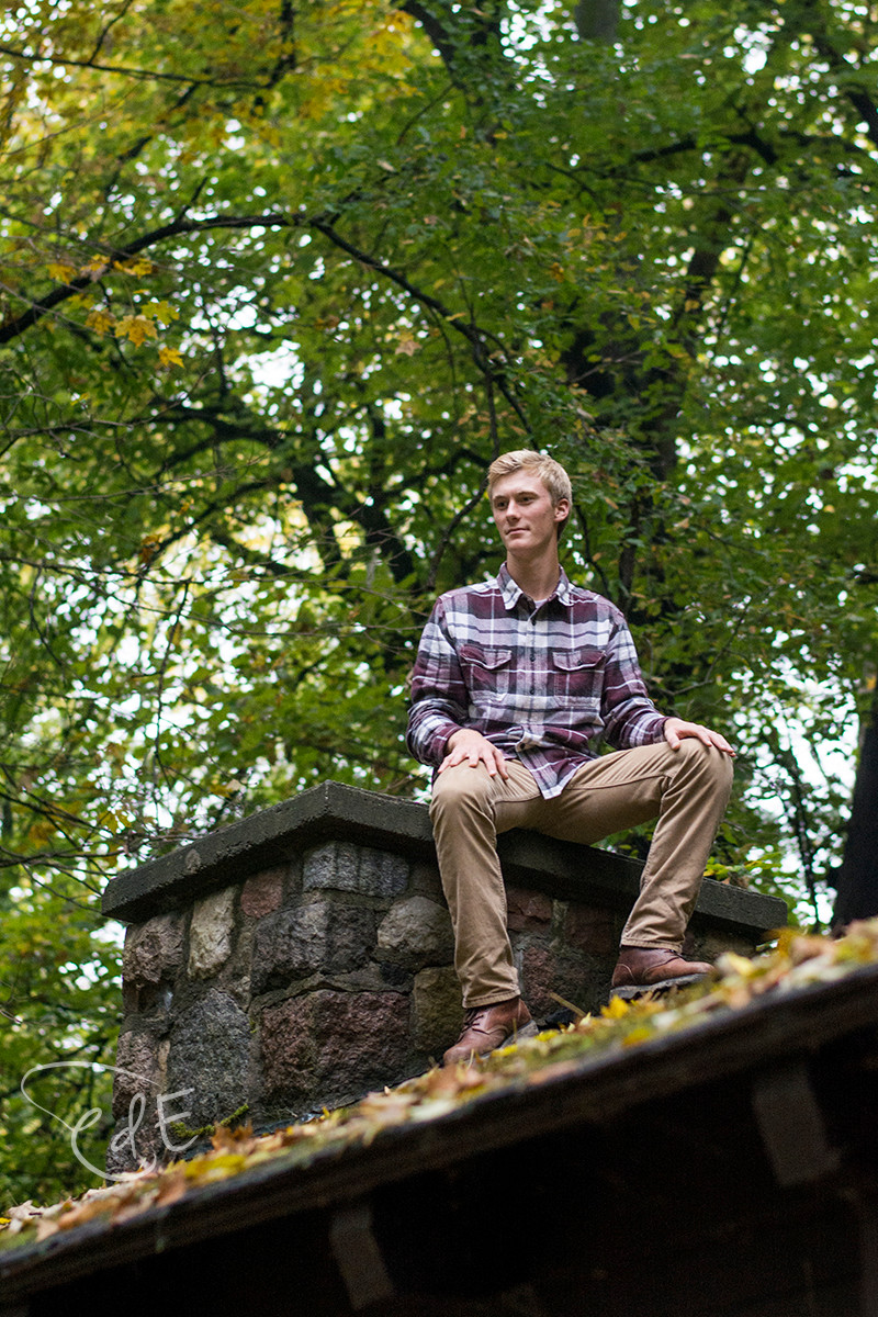 Male portrait sitting on cabin roof at Pokagon State Park