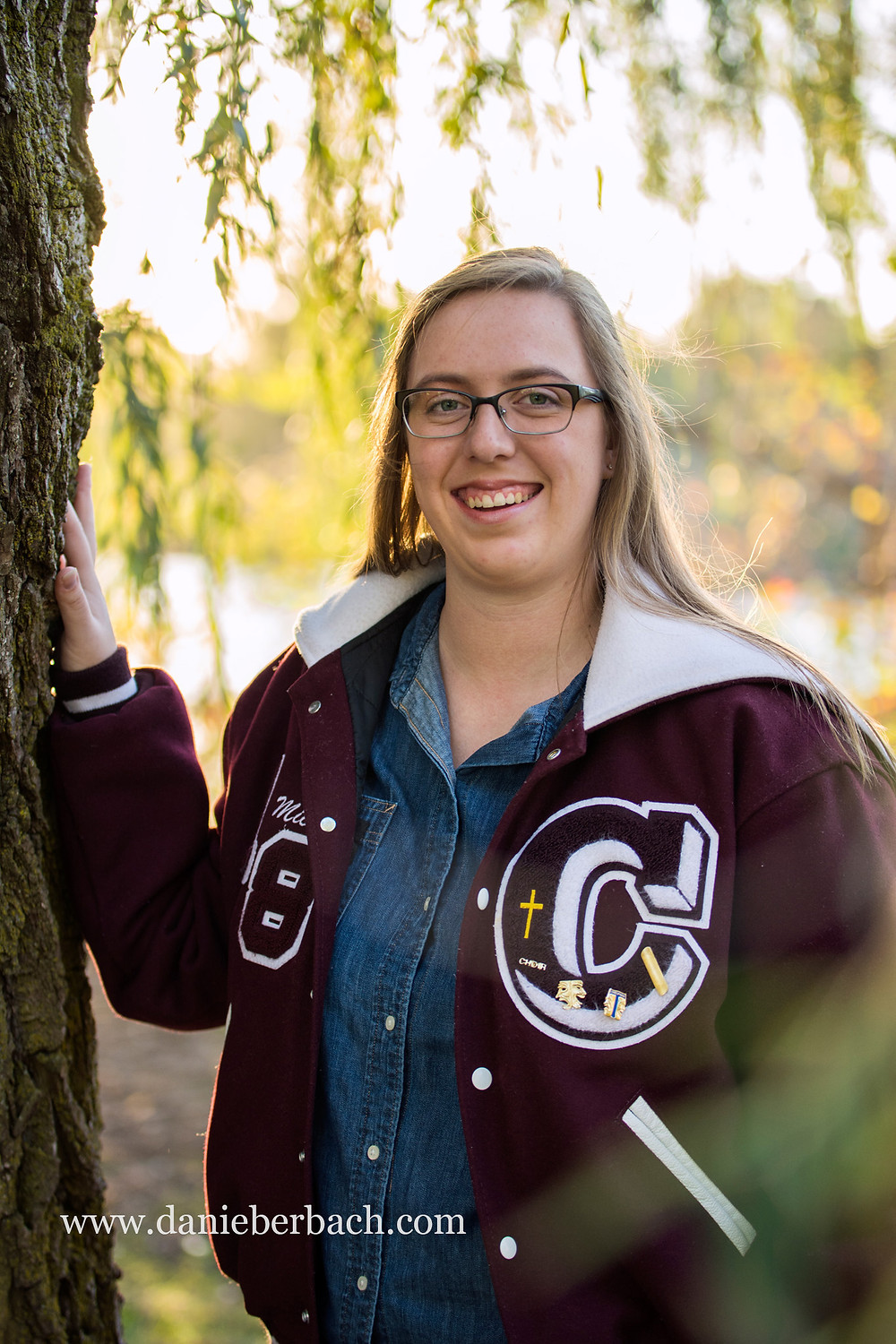 Senior portrait with letter jacket at IPFW
