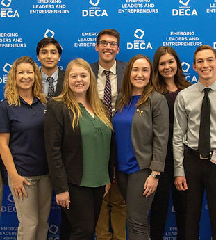 An Arizona Collegiate DECA Chapter celebrating a successful conference with a team photo
