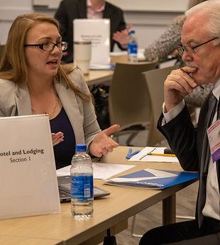AZ Collegiate DECA Competitor presenting a buisness plan to a judge