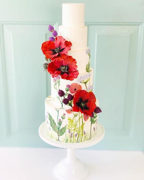 handpainted cake with sugar poppies
