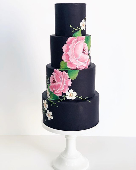 Fondant cake handpainted with edible cocoa butter paint