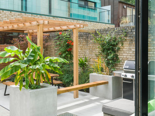 View out of sliding doors into a modern courtyard garden