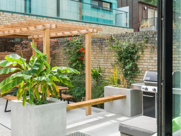 View out of sliding doors into a modern courtyard garden