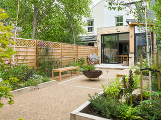 A contemporary cambridge garden design with raised beds made from limed new oak sleepers and a modern planting scheme