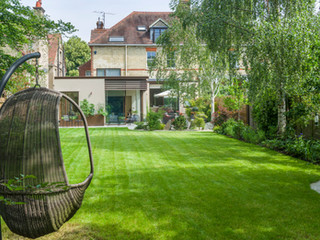 View of large lawn and architect designed house in Cambridge UK