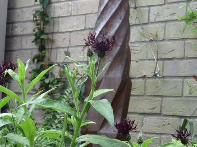 Wooden organic garden sculpture