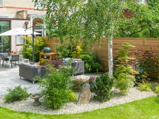A contemporary garden design in cambridge showing porcelain tiles and a modern minimalist planting scheme