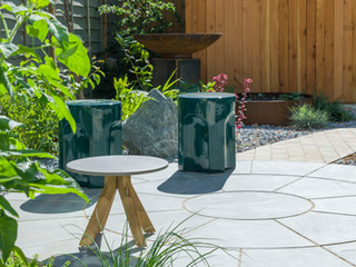 Garden furniture and a sawn sandstone paving patio in cambridge