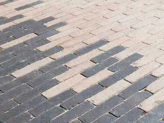 Close up of brick patio in two colours, beige and black