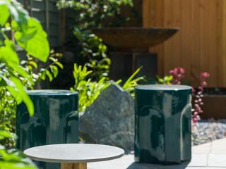 Corten water bowl in modern cambridge garden