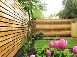 Larch slatted fencing in a garden design in cambridge
