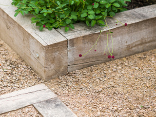 Close up of limed oak sleepers and breedon self binding gravel