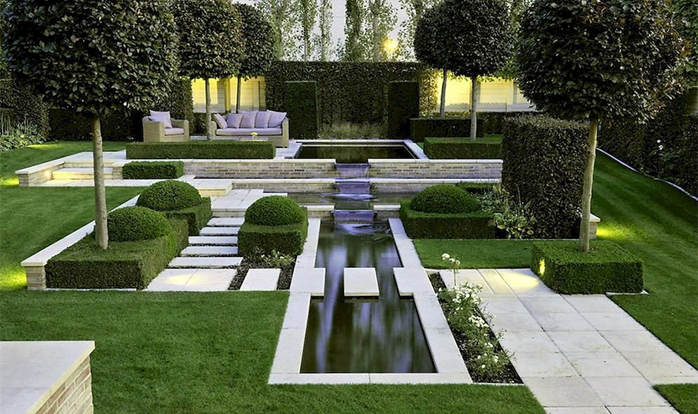 modern formal garden style with water formal water feature, clipped hedges and sawn paving