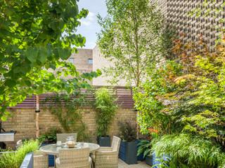 Stylish courtyard garden in cambridge with modular fibreglass planters as part of a garden design