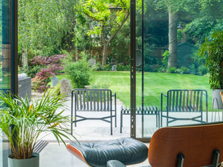 View out of a modern house into a garden designed by cultivate gardens cambridge