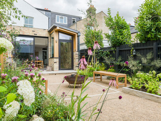 View of a modern formal garden design in cambridge UK with raised beds and acontemporary planting scheme