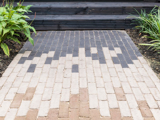 Close up photo of a brick art garden path blending three different colours of bricks