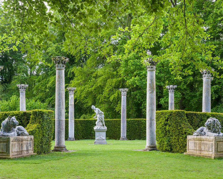 Formal garden with statues and collumns