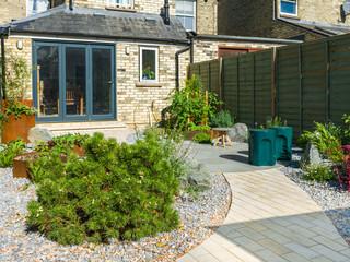 A modern gravel garden in cambridge designed by a garden designer