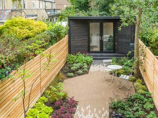top down view of a modern garden with a patio and path made with clay pavers in 3 colours diffusing into each other