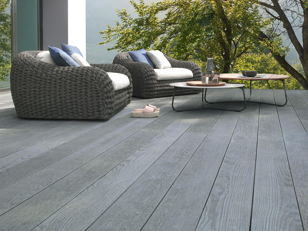Photo of Millboard composite decking and rattan furniture